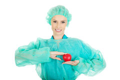 Female surgeon doctor with heart. Smiling female surgeon doctor with heart stock image