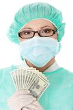 Female surgeon doctor holding money. Isolated on white background Stock Photography