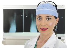 Female Surgeon and Foot X-rays. Close-up of a  beautiful female surgeon standing before her lightbox displaying foot x-rays.  On a white background Royalty Free Stock Images