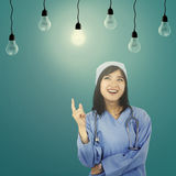 Female surgeon getting solution Royalty Free Stock Images