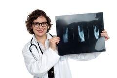 Female surgeon holding up x-ray sheet Royalty Free Stock Image