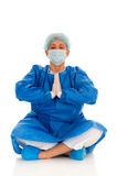 Female surgeon practicing yoga Royalty Free Stock Photo
