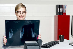 Female surgeon showing x-ray reports to camera Stock Images