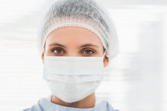 Female surgeon wearing surgical cap and mask Royalty Free Stock Photo