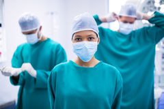 Female surgeon wearing surgical mask in operation theater. Of hospital Royalty Free Stock Photos