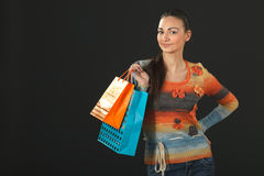 Female in sweater holding purchases Stock Images