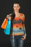 Female in sweater holding purchases Stock Photos