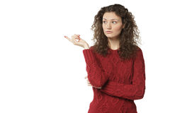 Female in sweater pointing at copy space Royalty Free Stock Photography