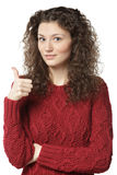 Female in sweater showing thumb up sign Royalty Free Stock Photos