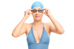 Female swimmer adjusting her goggles Royalty Free Stock Images