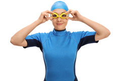 Female swimmer adjusting her swimming goggles. Isolated on white background Stock Photo