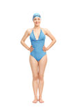 Female swimmer in a blue swimming costume Royalty Free Stock Image