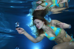 Female swimmer with camera Stock Images