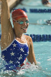 Female Swimmer Celebrating Victory In Pool. Closeup of a young female swimmer celebrating victory in the swimming pool Stock Photo