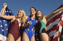 Female Swimmer Champions Holding American Flag Royalty Free Stock Photos