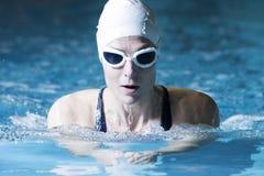 Female swimmer doing breaststroke exercise Stock Photo