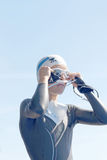 Female swimmer fixing the glasses Stock Photo