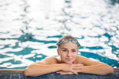 Female swimmer in an indoor swimming pool Stock Photos