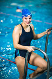 Female swimmer in an indoor swimming pool Stock Image
