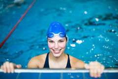 Female swimmer in an indoor swimming pool Royalty Free Stock Image