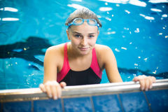 Female swimmer in an indoor swimming pool Royalty Free Stock Photography