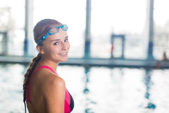 Female swimmer in an indoor swimming pool Stock Photo