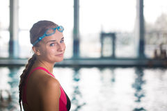 Female swimmer in an indoor swimming pool - going for her swim (. Shallow DOF Royalty Free Stock Images