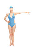Female swimmer pointing with her hand Royalty Free Stock Photo