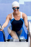 Female swimmer in a pool Royalty Free Stock Photo