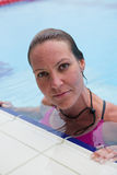 Female swimmer at pool edge Stock Photos
