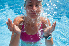 Female swimmer in pool Royalty Free Stock Photography