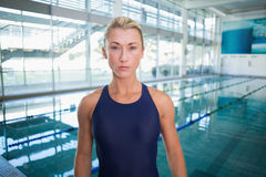 Female swimmer by pool at leisure center Royalty Free Stock Photography