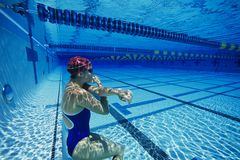 Female swimmer resting underwater Stock Photo