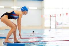 Female Swimmer on Start stock images