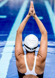 Female swimmer stretching Royalty Free Stock Photos