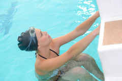 Female swimmer at swimming pool. Female swimmer at the swimming pool Stock Images