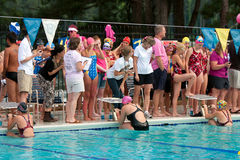 Female Swimmers Prepare To Start Backstroke Race. LAWRENCEVILLE, GA - JUNE 14:   Unidentified teenage female swimmers take their ready position to start Royalty Free Stock Image