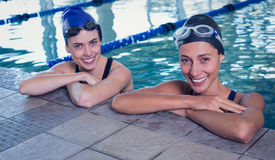Female swimmers smiling at camera in the swimming pool. At the leisure center Royalty Free Stock Image