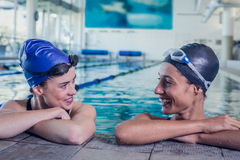 Female swimmers smiling at each other in the swimming pool. At the leisure center Stock Photography
