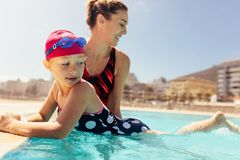 Mother teaching her daughter to swim royalty free stock photos