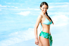Female swimsuit sea. Beautiful young female with swimsuit posing on the beach, studio shot Royalty Free Stock Images