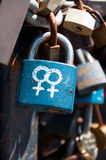 Female symbols on a lock. Padlock fastened on a bridge with the female symbols representing lesbian relations Royalty Free Stock Photography