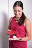 Female table tennis player is concentrating on next service Royalty Free Stock Image