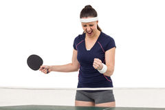 Female table tennis player posing after victory Royalty Free Stock Photo