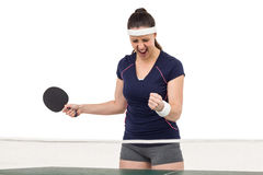Female table tennis player posing after victory. On white background Stock Images