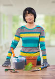 Female at table with tools for repot plowers Stock Images