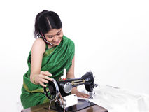 Female tailor her cell phone Royalty Free Stock Photography