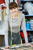 Female tailor portrait at workplace Royalty Free Stock Photos