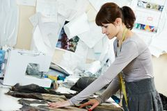 Female tailor portrait at workplace Royalty Free Stock Images