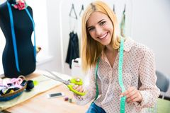Female tailor standing in workshop Stock Image